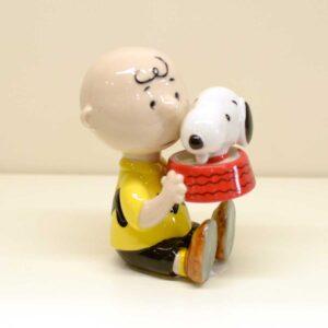 Charlie Brown e Snoopy con ciotola